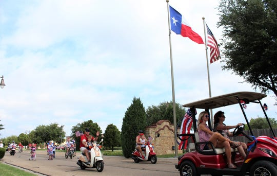 With the Texas and U.S. flags flapping in the breeze, the Lone Star Ranch Neighborhood Parade begins Thursday morning in south Abilene.