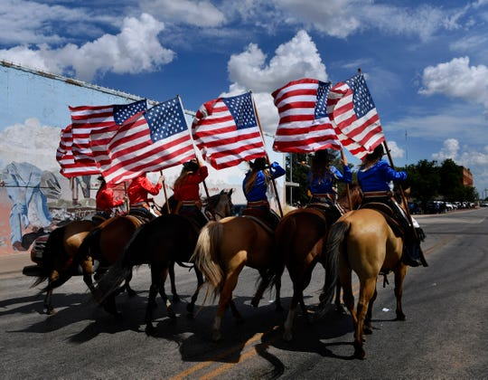 An equestrian group rides down N. Swenson St. in Stamford during Wednesday's Texas Cowboy Reunion Parade. This is the 89th year for the rodeo. This is the 89th year for the rodeo which concludes Saturday.