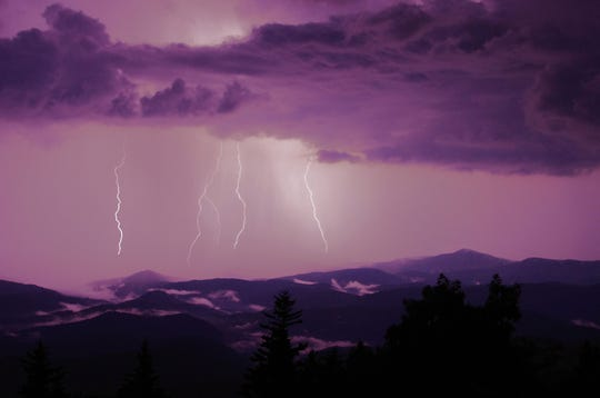 Lighting strikes over Lost Cove Cliffs during a recent storm, as seen from Grandfather Mountain. The mountain itself experienced some dramatic weather this past June, when it recorded 15.94 inches of rain — the park's wettest June on record.