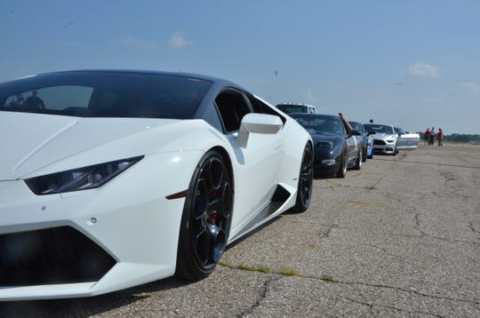 A Lamborghini LC F10 leads a pack of cars to the starting line during Speedfest at W.K. Kellogg Airport on Thursday, July 4, 2019.