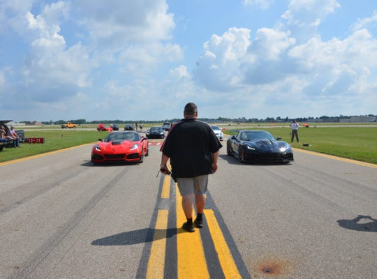 Brad Long, chair of the Battle Creek Speedfest, brings a pair of Corvette's to the starting line for a practice run at W.K. Kellogg Airport on Thursday, July 4, 2019.