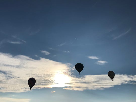 Balloons flying Thursday morning.