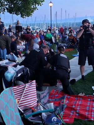 Law enforcement responds to Poulsbo's waterfront park on Wednesday where a large crowd was gathered for the Third of July fireworks show.