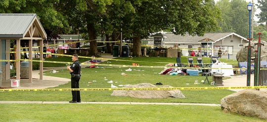 Poulsbo Police Officer Nick Hoke stands watch over the scene of the officer-involved shooting that took place prior to the 3rd of July fireworks at the Poulsbo Waterfront on Thursday, July 4, 2019.
