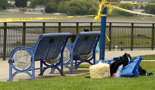Personal belongings left on the lawn after the officer-involved shooting prior to the 3rd of July fireworks at the Muriel Iverson Williams Waterfront Park in Poulsbo.