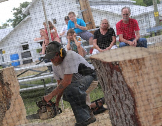 A woodcarver who entertained fairgoers during the 2018 fair will be back this year, fair officials said.