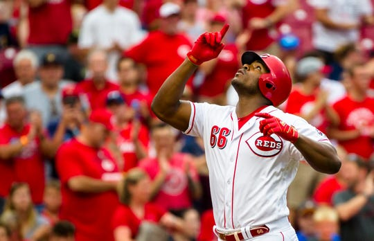 Cincinnati Reds right fielder Yasiel Puig (66) crosses home plate after hitting a home run in the second inning of the MLB baseball game between Cincinnati Reds and Milwaukee Brewers on Wednesday, July, 3, 2019, at Great American Ball Park in Cincinnati.