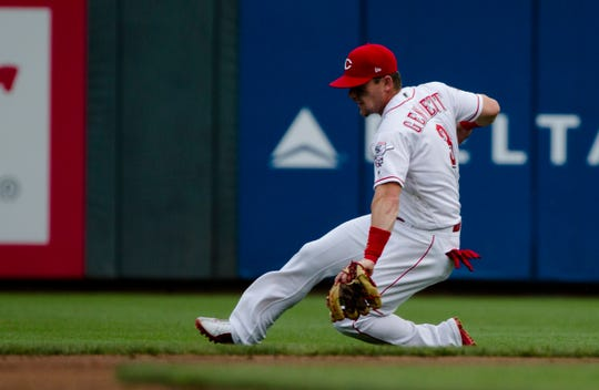 Cincinnati Reds second baseman Scooter Gennett (3) picks up a ground ball in the second inning of the MLB baseball game between Cincinnati Reds and Milwaukee Brewers on Wednesday, July, 3, 2019, at Great American Ball Park in Cincinnati.