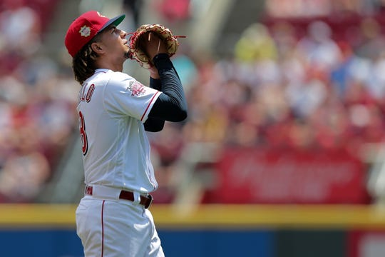 Cincinnati Reds starting pitcher Luis Castillo (58) walks off the mound in the first inning of an MLB baseball game against the Milwaukee Brewers, Thursday, July 4, 2019, at Great American Ball Park in Cincinnati.