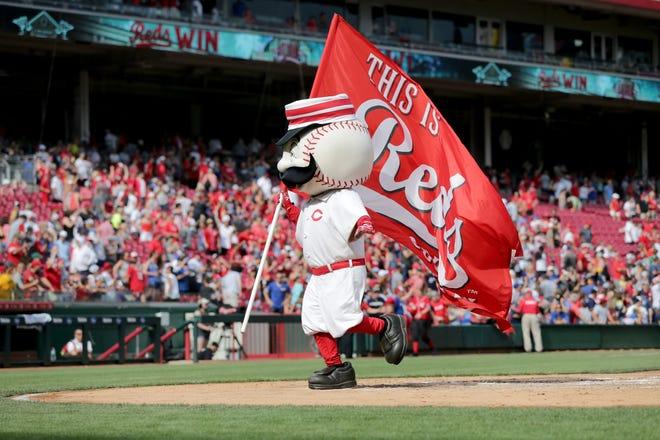 Cincinnati Reds mascot Mr. Redlegs celebrates a win for the team in 2019, at Great American Ball Park.