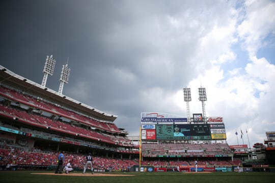Rain clouds roll in over the stadium in the fifth inning of an MLB baseball game between the Milwaukee Brewers and the Cincinnati Reds, Thursday, July 4, 2019, at Great American Ball Park in Cincinnati.