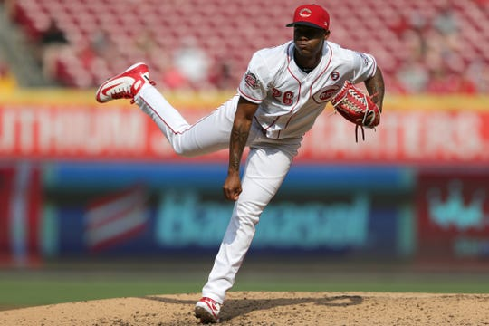 Cincinnati Reds relief pitcher Raisel Iglesias (26) delivers in the ninth inning of an MLB baseball game against the Milwaukee Brewers, Thursday, July 4, 2019, at Great American Ball Park in Cincinnati. The Cincinnati Reds won 1-0.