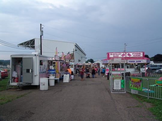 Food vendors and rides lined the midway at the Coshocton County Fairgrounds for the Freedom Celebration.