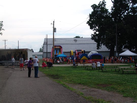 New this year at the Freedom Fest was a kids' zone with games and inflatables overseen by members of Real Youth, the youth ministry at the Coshocton Church of the Nazarene.