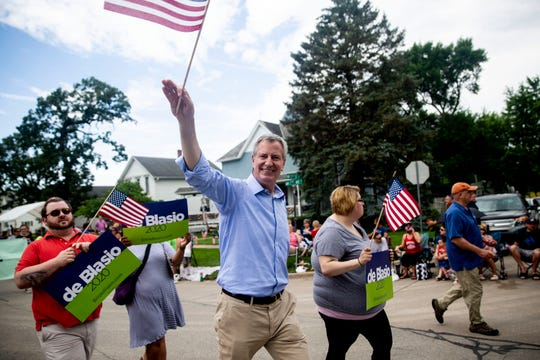 Cameron Mackaw-Hennick, seen here in red at the Fourth of July parade in Independence, Iowa, has been named Mayor Bill de Blasio's Iowa field director.