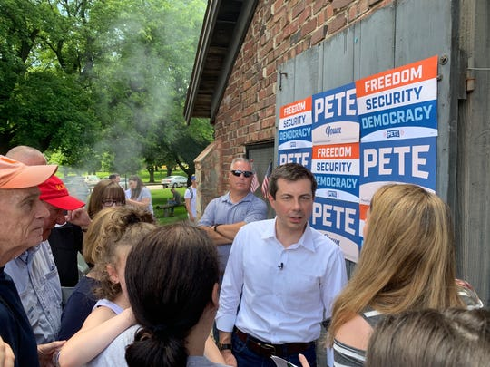 Presidential candidate Pete Buttigieg meets with voters during a campaign event in Carroll, Ia., on July 4, 2019.