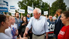 U.S. senator and current Democratic presidential candidate hopeful Bernie Sanders greeted supporters during the Independence Day parade in West Des Moines on Wednesday, July 3, 2019.