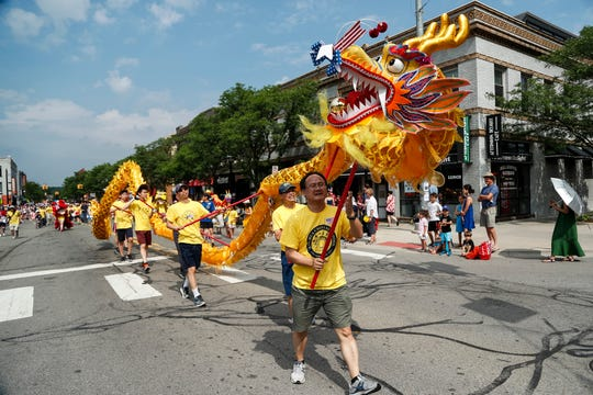 Chinese Dragon Dance is performed during the annual Fourth of July parade in downtown Ann Arbor, Thursday, July 4, 2019.