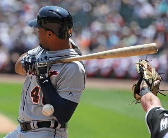 Jeimer Candelario #46 of the Detroit Tigers is hit by a pitch in the 1st inning against the Chicago White Sox at Guaranteed Rate Field on July 03, 2019 in Chicago, Illinois.
