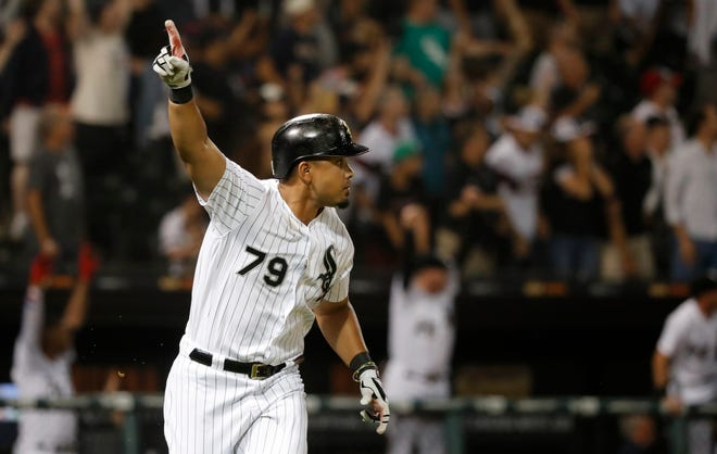 Chicago White Sox's Jose Abreu celebrates his three-run, walk-off home run during the 12th inning on Wednesday.
