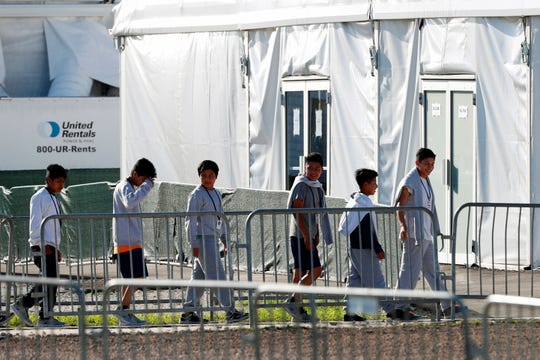 In this Feb.19, 2019 file photo, children line up to enter a tent at the Homestead Temporary Shelter for Unaccompanied Children in Homestead, Fla.
