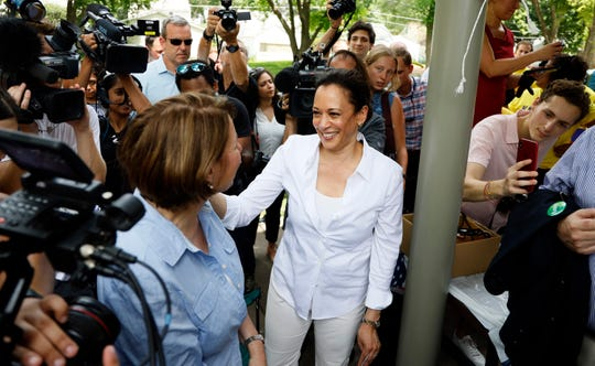 Democratic presidential candidates Sen. Kamala Harris and Sen. Amy Klobuchar, left, talk during the West Des Moines Democrats' annual picnic, Wednesday, July 3, 2019, in West Des Moines, Iowa.