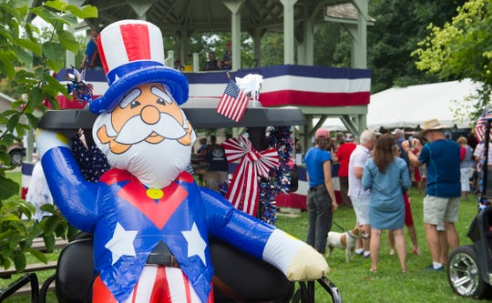 A blowup of Uncle Sam sits on the back of a golf cart during a Fourth of July picnic at Maclure Park in New Harmony Indiana Thursday, July 4, 2019.