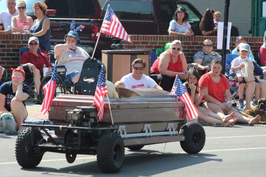 Crazy Bob Turner of Haunted Hydro drives in his casket car during the annual July 4 parade in Fremont.