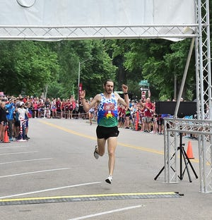 Jerrell Mock, a former Colorado State University standout, wins the elite race Thursday, July 4, 2019, in the 20th annual FireKracker 5k at Fort Collins' City Park.