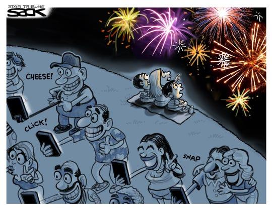Watching vs. recording fireworks.