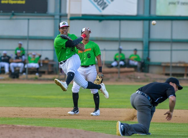 Great Falls Voyagers shortstop Lency Delgado makes a running throw to first base during Wednesday's game against Billings at Centene Stadium.