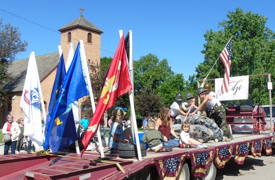Children create an Iwo Jima tableau on a float in the Choteau 4th of July parade.