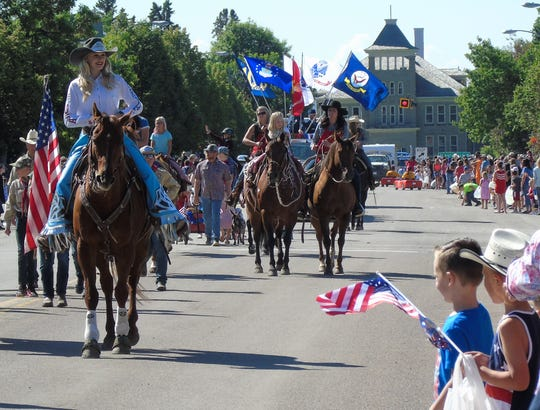 Horses and Scouts lead the way in the Choteau 4th of July parade on Thursday. With perfect weather the crowd was big.
