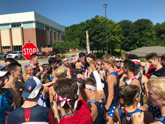 The CarmelFest runners regroup after their parade run.