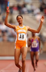 Tennessee's Kameisha Bennett reacts as she crosses the finish line, anchoring the college women's spring medley championship of America at the Penn Relays on Friday, April 23, 2004, in Philadelphia. Tennessee set a Penn Relays and collegiate record with a time of 3 minutes, 41.78 seconds.