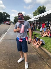 A staple of Erath's annual Fourth of July celebration is Adam Broussard and his spray-painted beard. His mom and wife sprayed the facial hair to look like an American flag, continuing the tradition for a third year. He topped off the ensemble with stars-and-stripes sunglasses and fanny pack with an attached koozie.