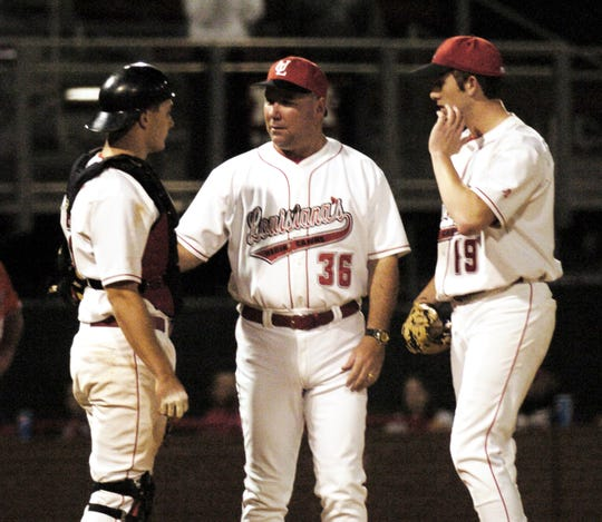 "UL head baseball coach Tony Robichaux talks with catcher Jonathan Lucroy, left, pitcher C.J. Blue during a 2005 game against Northwestern State University at M.L. ""Tigue"" Moore Field."
