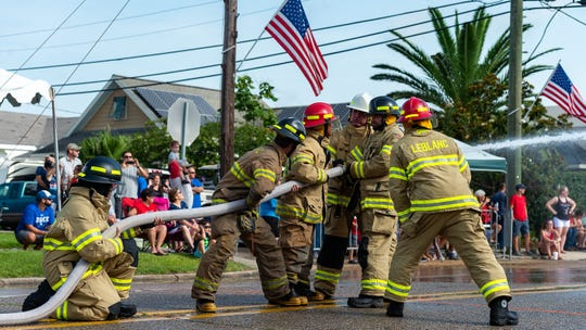Firefighters compete in the annual Fourth of July water fights in Erath, Louisiana. Delcambre, Henry, Erath, and Leblanc were among the local departments competing this year.