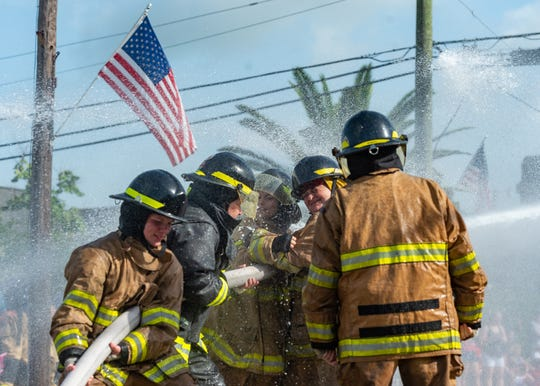 Firefighters compete in the annual Fourth of July water fights in Erath, Louisiana. Delcambre, Henry, Erath, and Leblanc were among the local departments competing. Thursday, July 4, 2019.