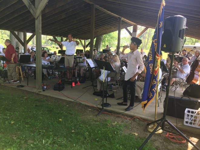Jody Odom Jr. sings while Steve Taylor directs the American Federation of Musicians Local 159 at Thursday's Pastoral in the Park celebration.