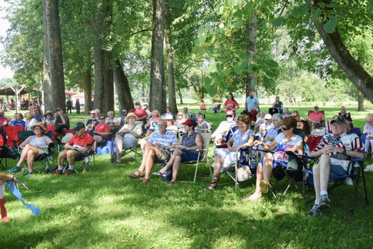 People enjoy the music of the American Federation of Musicians Local 159 at Thursday's Pastoral in the Park celebration.