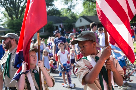 Brady St. Gelais, 12, left, and Ramsey Hall, 12, from Boy Scout Troop 40 prepare for the start of the 70th annual High Point Terrace Independence Day parade, July 04, 2019.
