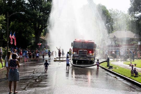 Firefighters from Memphis Fire Station 17 spray water for the crowd at the end of the 70th annual High Point Terrace Independence Day parade, July 04, 2019.