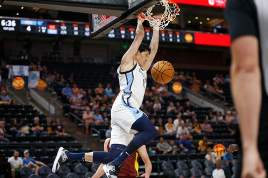 Memphis Grizzlies forward Yuta Watanabe dunks against the Cleveland Cavaliers during the first half of an NBA summer league basketball game Wednesday, July 3, 2019, in Salt Lake City.