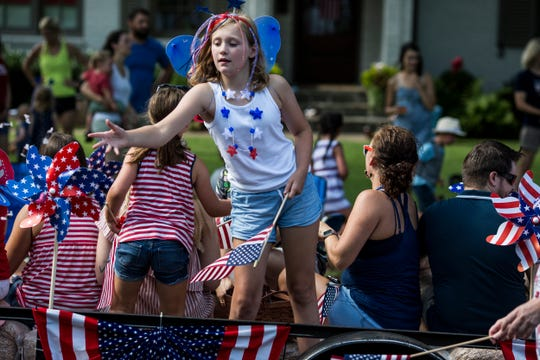 Cadence Cottam, 9, tosses candy from the Layson Group float during the 70th annual High Point Terrace Independence Day parade, July 04, 2019.