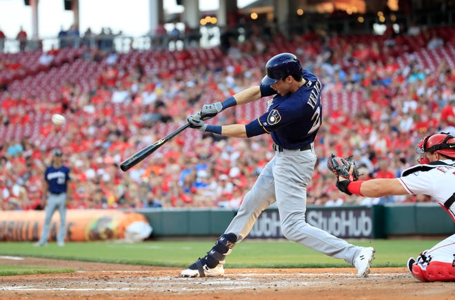 Christian Yelich hits a home run against the Cincinnati Reds at Great American Ball Park on July 2.