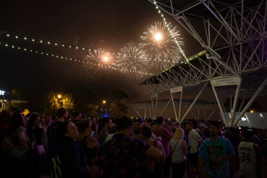 Festival goers watch fireworks over Lake Michigan as The Roots perform at the BMO Harris Pavilion on July 3, 2019.