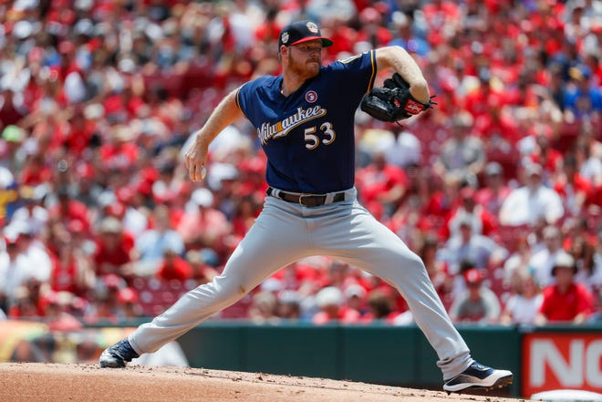 Brandon Woodruff is tied for the lead in the NL with 10 wins, and the Brewers are 14-4 in games he has started.