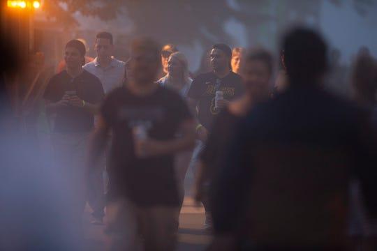 Festival goers walk through the fog on Wednesday, July 3, 2019 at Summerfest.
