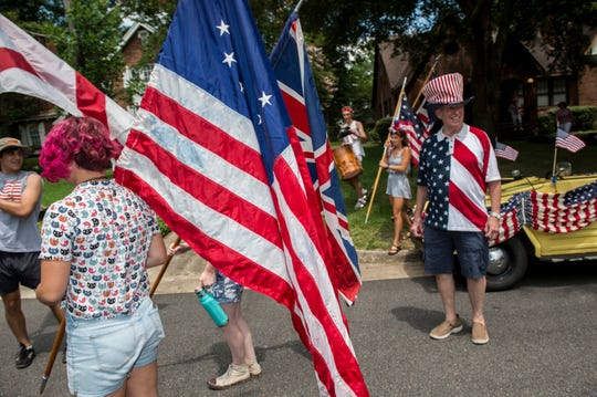 Parade organizer Charlie Colvin starts the Cloverdale-Idlewild Fourth of July parade in Montgomery, Ala., on Thursday, July 4, 2019.